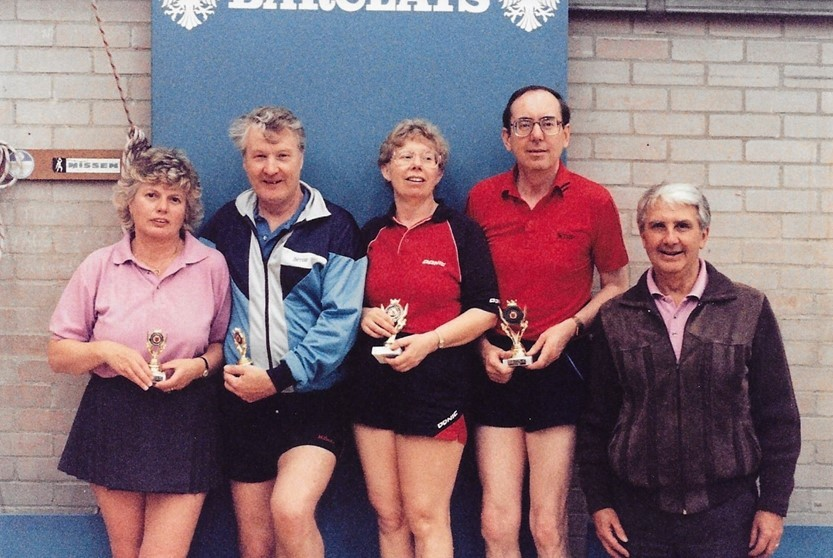 1991 Essex Closed with Peter and Linda Radford (winners), Mike Watts and Jean Wadling (runners up)  trophies presented by Bill Wadling for the Veterans Mixed Doubles.